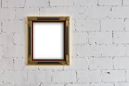 Old Wood and Gold Picture frame Hanging on White block wall photo