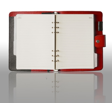 open diary: Red Leather cover binder book and reflection Stock Photo