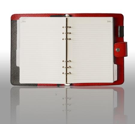 Rote Ledereinband Binder Buch und Reflexion Standard-Bild - 10922833