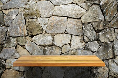 shelf: Wood shelf on dark old rock wall Stock Photo