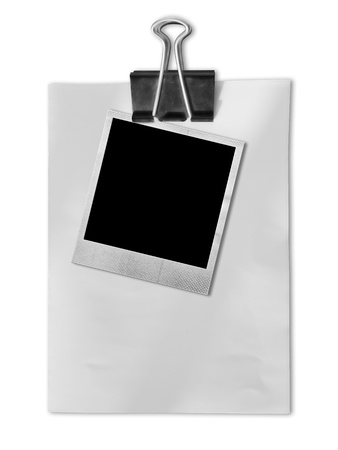 Old photo frame on white paper with black clipboard Stock Photo - 11242836