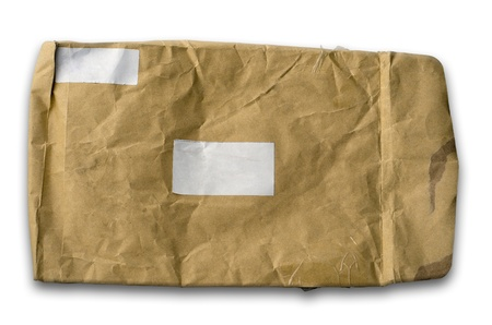 Old wrinkled brown paper envelope and a white label photo