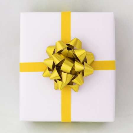 Top view of Gold star and Cross line ribbon on White paper box, Gift for Special Day photo