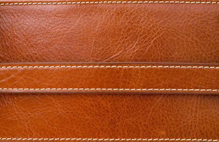 Texture of brown leather and Stitched with white thread Stock Photo