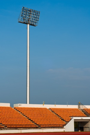 Contemporary stadium Orange seat light and track with blue sky