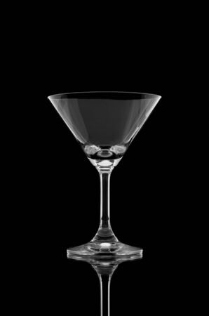 crystal glass: Empty cocktail glass on black background and reflect
