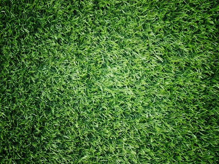 Texture and surface of green turf center light for sport background photo