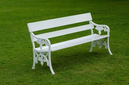 garden bench: White Bench on green lawn in the garden Stock Photo