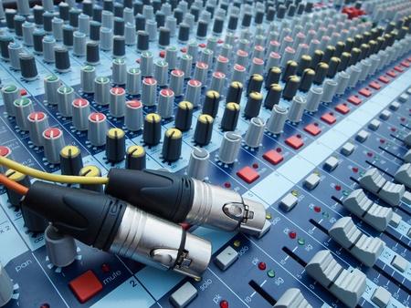 Plug and volume control knob on the panel photo