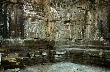 coping: Carved on The enclosure wall is laterite with decorative sandstone coping. Preah Khan, Angkor