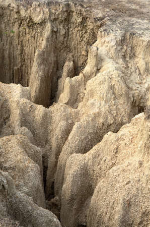 steep cliff: The subsidence of the ground has created a steep cliff