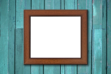 Brown wood picture frame on Green plank wall with shadow photo