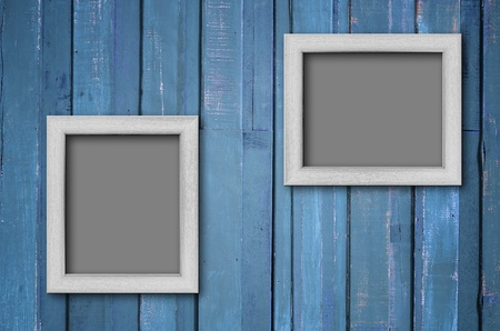 Two white wood picture frame on Blue color paint plank wall for background Stock Photo - 13181336
