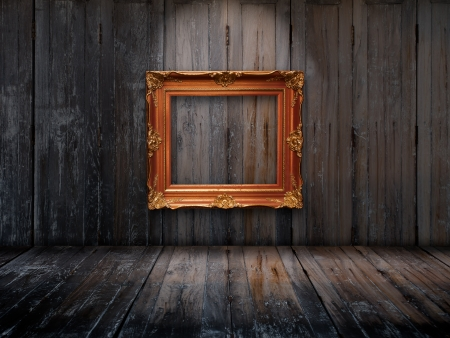 Old picture frame on wooden wall and Top light photo