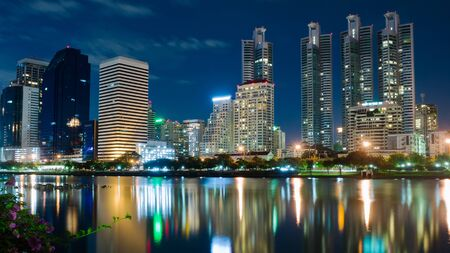 Night Lights Building in Bangkok and Reflection photo