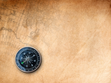 Black Compass on Brown Paper with old map Print background  photo