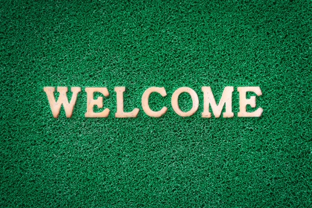 Light Welcome Text On Green Carpet Texture Stock Photo Picture And