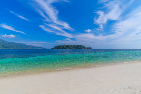 Clear water and blue sky at the paradise island in the tropical sea of Thailand