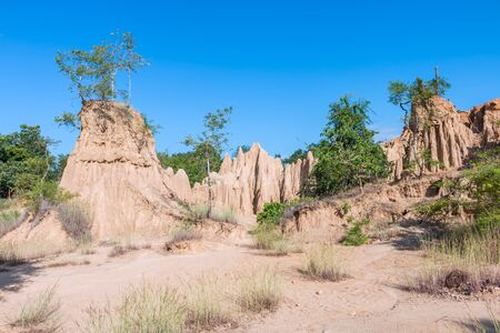 Sao Din Na Noi,soil textures eroded sandstone pillars, columns and cliffs, Nan Province,Thailand