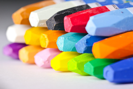 Oil Pastel Crayons on a white paper photo