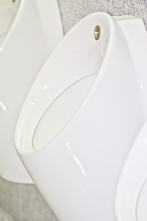 cultural artifacts: Pattern of white urinals for men in toilet Stock Photo