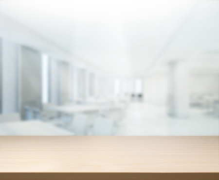 interior spaces: Table Top And Blur Office of Background Stock Photo