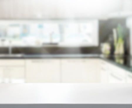 a kitchen: Table Top And Blur Interior of Background Stock Photo