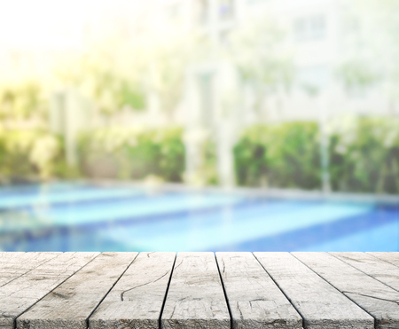 hotel with pool: Wood Table Top Of Background And Pool