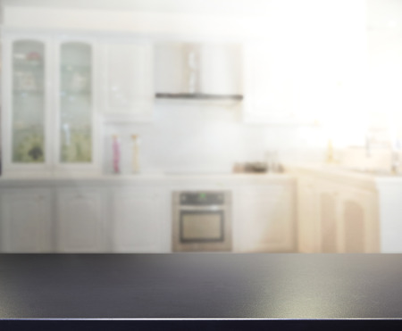 kitchen counter top: Table Top And Blur Interior of The Background Stock Photo