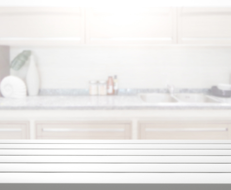 kitchen furniture: Table Top And Blur Kitchen Room of The Background Stock Photo
