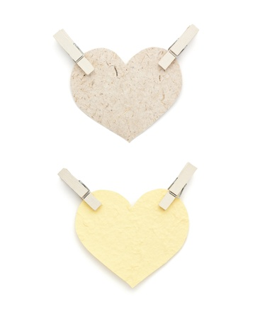 Mulberry paper heart shape with pin isolated on white photo