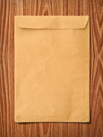 Envelope documents on vintage wood photo