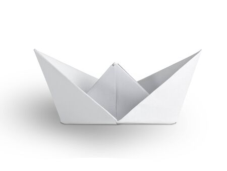 Origami paper ship on white background photo