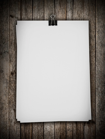 White paper on wood background photo