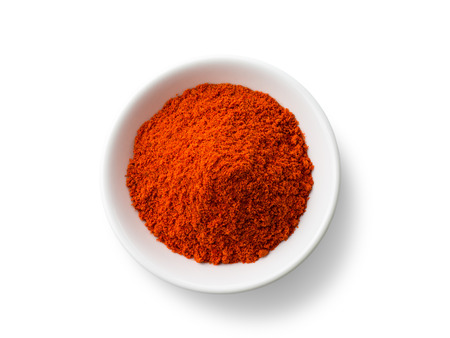 dry powder: Paprika powder isolated on white background