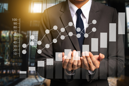 Data Management System with businessman working with provide information for Key Performance Indicators and marketing analysis virtual computer