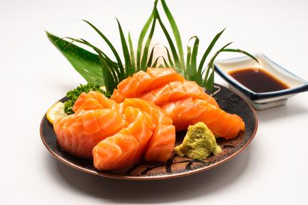 Sashimi, Salmon, Japanese food chopsticks and wasabi on the  table 免版税图像 - 116566408