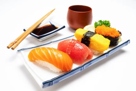 Sushi salmon & tuna sushi shrimp and wasabi on the white plate isolated.selective focus 免版税图像