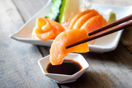 Sashimi, Salmon, Japanese food chopsticks and wasabi on the table