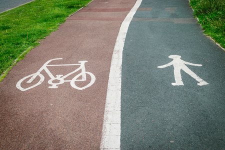 pedestrian sign: Bicycle and pedestrian sign painted on the road asphalt Archivio Fotografico