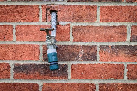 metal pattern: Faucet in a brick wall