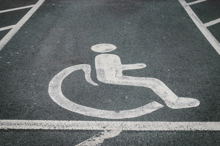 disabled parking sign: handicapped  disabled parking sign painted on the road asphalt Stock Photo