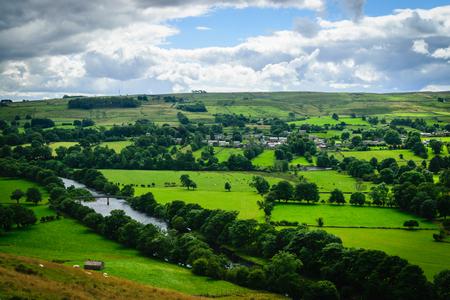 meandering: Meandering River making its way through lush green rural farmlan
