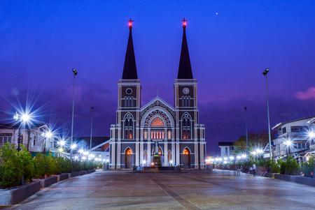 Roman Catholic church and Saint Mary statue at twilight time, a landmark in Chanthaburi, Thailand.