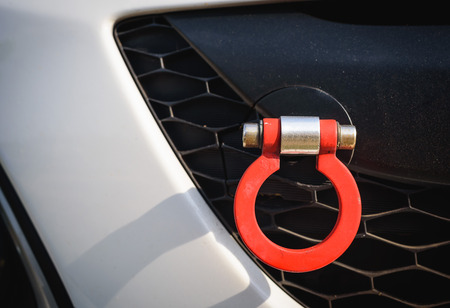 towing: Red towing hook vehicle.