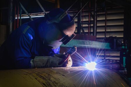 Welding steel structures and bright sparks with lens flare