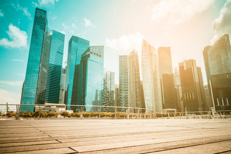 day light: Singapore city skyline of business district downtown in daytime. Vintage tone