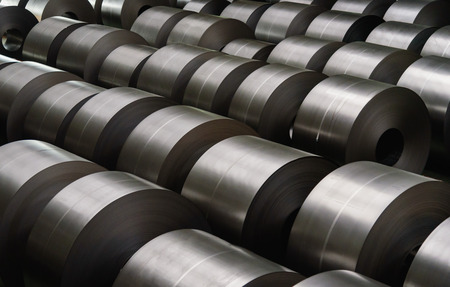 Cold rolled steel coil at storage area in steel industry plant. 免版税图像