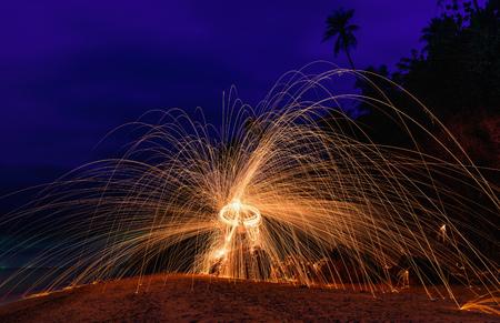 steel wool: Burning steel wool on stone near the beach.
