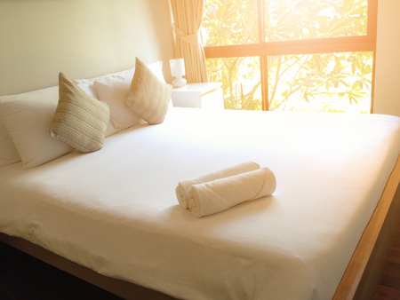 White Towel on the bed in the bedroom at hotel.